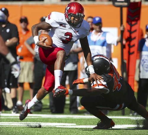 Eastern Washington  quarterback Vernon Adams Jr. (3) vaults the defense of Oregon State linebacker Jabral Johnson (44) in the first half of an NCAA college football game  Saturday Aug. 31, 2013 in Corvallis, Ore.   (AP Photo/The Oregonian, Randy L. Rasmussen)