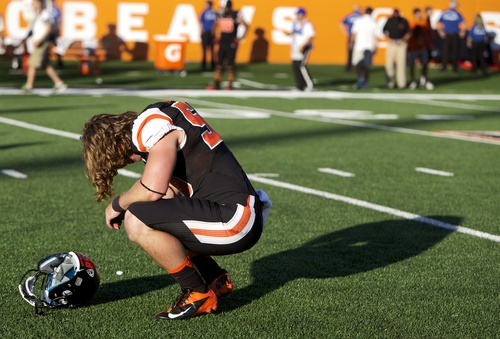 Oregon State long snapper Michael Morovick (58) reacts after the Beavers' 49-46 loss to Eastern Washington in an NCAA college football game Saturday Aug. 31, 2013 in Corvallis, Ore.   (AP Photo/The Oregonian, Randy L. Rasmussen)