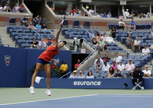 Ana Ivanovic, of Serbia, serves to Victoria Azarenka, of Belarus, during the quarterfinals of the 2013 U.S. Open tennis tournament, Tuesday, Sept. 3, 2013, in New York. (AP Photo/Julio Cortez)