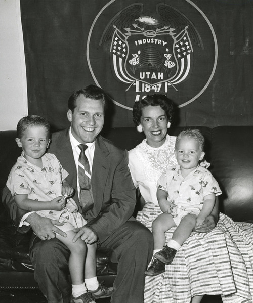 | The Salt Lake Tribune Library Rep. Douglas R. Stringfellow (R-Utah), who tonight admitted his story of World War II Cloak and dagger adventures was a hoax, posed only a few weeks ago as a laughing and happy family man. Martin, 2 1/2, while Mrs. Stringfellow holds son Dwight David, 1 1/2. Mrs. Stringfellow ,met her husband while entertaining wounded veterans at Bushnell Hospital, Brigham City, Utah. AP Wirephoto 1954