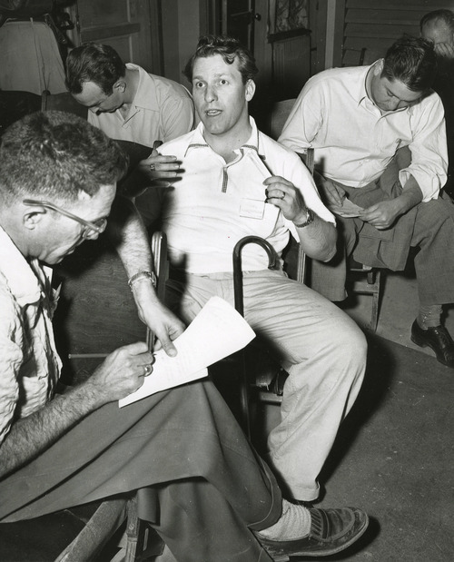 | The Salt Lake Tribune Library Rep Douglas Stringfellow, (R-Utah) center, gives his eye witness account at newsmen at a press conference at Indian Springs Air Base, Nevada, following the firing of the first atomic artillery shell on Frenchmen Flat. AP Wire Photo 5/16/1953