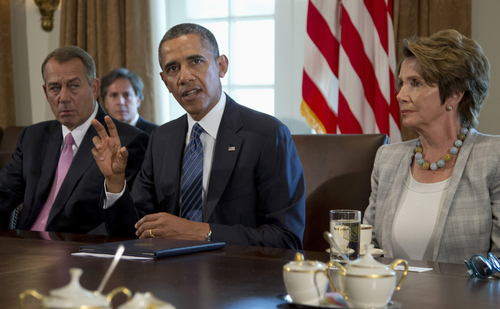 President Barack Obama, flanked by House Speaker John Boehner of Ohio, left, and House Minority Leader Nancy Pelosi of Calif.,  speaks to media in the Cabinet Room of the White House in Washington, Tuesday, Sept. 3, 2013, before a meeting with members of Congress to discuss the situation in Syria.  (AP Photo/Carolyn Kaster)