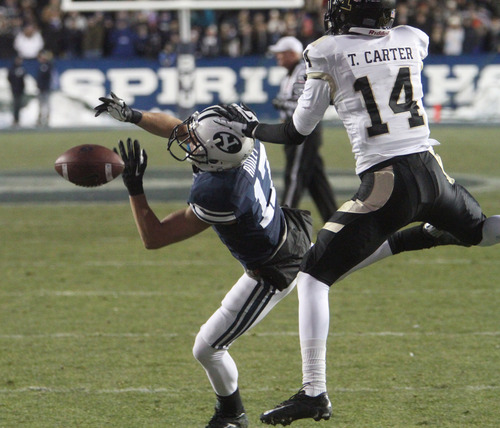 Rick Egan  | The Salt Lake Tribune   Brigham Young Cougars wide receiver Skyler Ridley  is hit by (17) Tracey Carter of the Vandals on a touchdown pass attempt, in football action, at Lavell Edwards Stadium, Saturday, November 10, 2012