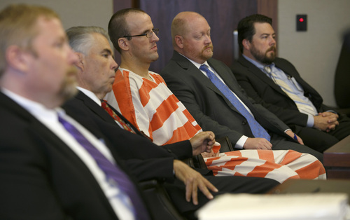 Jud Burkett  | Pool The Spectrum & Daily News Deputy Washington County Attorney Brian Filter, left, listens as Judge James L. Shumate addresses Paul Clifford Ashton while he sits surrounded by his defense tea during his sentencing hearing in Fifth District Court Wednesday, Sep. 4, 2013 in St. George, Utah. Ashton was sentenced to life without parole for Brandie Jerden's 2010 murder and will serve the sentence concurrently with a federal sentence of life in prison for the murder of Bradley Eitner which he committed in October of 2010, two months prior to the murder of Jerden.