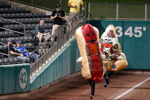 Trent Nelson  |  The Salt Lake Tribune A hot dog races a slice of pizza in the eighth inning as the Utah Bees face the Las Vegas 51s at Spring Mobile Ballpark in Salt Lake City Wednesday, September 4, 2013.