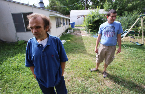 Francisco Kjolseth     The Salt Lake Tribune Steven Roe, left, a paralegal who hit hard times and had been approved for section 8 housing was helped by DeVaughn Simper, a father of three young children, who decided to rent his basement when he was out of work earlier this year. Simper who was looking to supplement his income as they continue to struggle, is paying it forward with Roe, a paralegal who hit hard times and had to wait two months for the subsidy to start due to a glitch in the system.