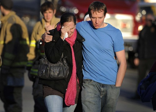 File  |  The Associated Press Alissa Parker, left, and her husband, Robbie Parker, leave the firehouse on Dec. 14, 2012 after receiving word that their six-year-old daughter Emilie was one of the 20 children killed in the Sandy Hook School shooting in Newtown, Conn. The couple are quoted in  new report about child safety during disasters, urging states to adhere to certain standards.
