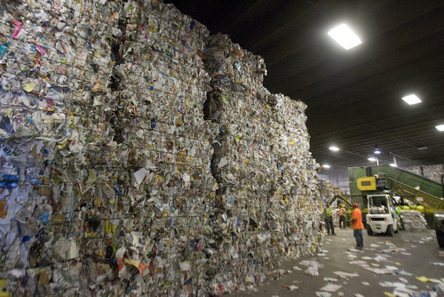 "Paul Fraughton  |   Salt Lake Tribune  A mountain of recycled paper  towers over workers  at the Rocky Mountain Recycling facility. At the facility,  Salt Lake County Mayor, Ben McAdams announced a new recycling push, with the goal of doubling the county's recycling. Recycling trucks will display a ""wrap"" with the slogan, ""Start a New Cycle. Recycle.""  as well as a web address, ""recycle.slco.org"" where people can get information about recycling.                    Wednesday, September 4, 2013"