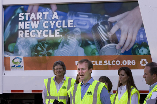 "Paul Fraughton  |   Salt Lake Tribune  Salt Lake County Mayor Ben McAdams  standing in front of a recycling truck,  announces a new recycling push with the goal of doubling the county's recycling. Recycling trucks will display a ""wrap"" with the slogan, ""Start a New Cycle. Recycle.""  as well as a web address, ""recycle.slco.org"" where people can get information about recycling.                    Wednesday, September 4, 2013"