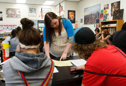 Trent Nelson  |  The Salt Lake Tribune Teacher Kellie Fay works with students at Polaris High School Friday, August 30, 2013 in Orem.