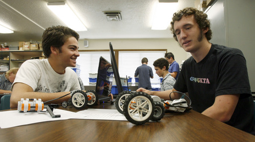 "Francisco Kjolseth  |  The Salt Lake Tribune Adam Bean, 16, left, and Tucker Morris, 16, spend time with their robotic creations in their Mechatronics class at the Utah Academy of Sciences. The Utah State Office of Education released the school grades and rankings mandated by the state legislature in which UCAS received an ""A"" grade earning 642 of 750 points, indicating the highest academic ranking in the state. UCAS is a public early college STEM (Science, Tech, Engineering & Math) charter school located on the UVU campus in Orem."