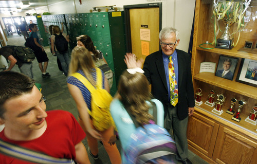 Francisco Kjolseth  |  The Salt Lake Tribune Clark Baron, Executive Principal and CEO of the Utah Academy of Sciences gives morning high fives to some of his 410 students during a morning classroom change. The Utah State Office of Education released the school grades and rankings mandated by the state legislature in which UCAS received an ìAî grade earning 642 of 750 points, indicating the highest academic ranking in the state. UCAS is a public early college STEM (Science, Tech, Engineering & Math) charter school located on the UVU campus in Orem.