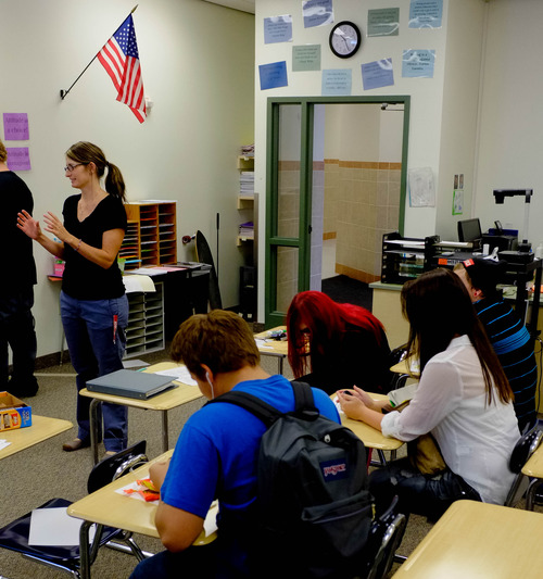 Trent Nelson  |  The Salt Lake Tribune Teacher Allison Mower works with students at Polaris High School Friday, August 30, 2013 in Orem.