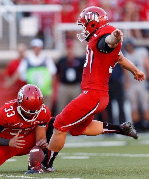 Trent Nelson  |  The Salt Lake Tribune Utah Utes kicker Andy Phillips (39) scores an extra point, with running back Marcus Williams (33) holding the ball as the University of Utah hosts Utah State, college football Thursday, August 29, 2013 at Rice-Eccles Stadium in Salt Lake City.