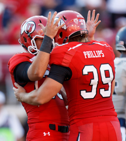 Trent Nelson  |  The Salt Lake Tribune Utah Utes running back Marcus Williams (33) and kicker Andy Phillips (39) celebrate an extra point as the University of Utah hosts Utah State, college football Thursday, August 29, 2013 at Rice-Eccles Stadium in Salt Lake City.