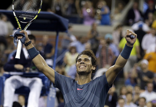 Rafael Nadal, of Spain, celebrates after defeating Tommy Robredo, of Spain, 6-0, 6-2, 6-2 in a quarterfinal of the U.S. Open tennis tournament Wednesday, Sept. 4, 2013, in New York. (AP Photo/Darron Cummings)
