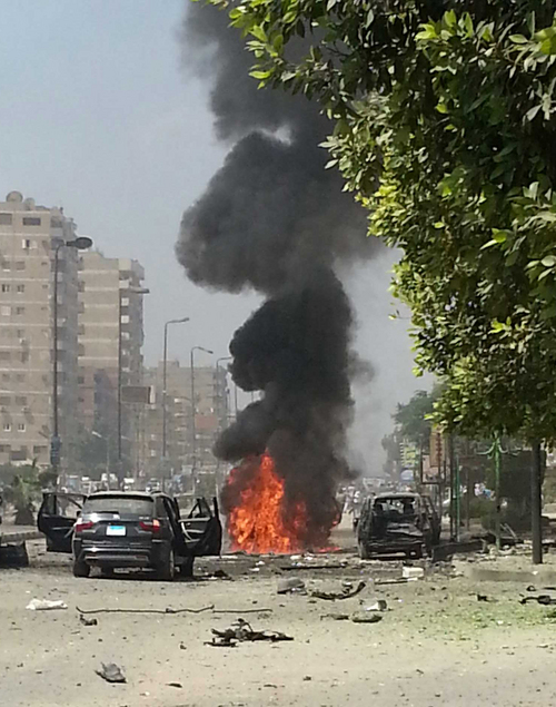 Black smoke billows from a burning car moments after a bomb attack targeted the convoy of Egypt's Interior Minister Mohammed Ibrahim, in Nasr City, Egypt, Thursday, Sept. 5, 2013. It was the first attack on a senior government official since a coup toppled the country's Islamist president July 3, 2013. (AP Photo/Ahmed Soliman)