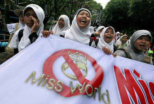 Dita Alangkara  |  The Associated Press Muslim women chant slogans during a protest demanding the cancellation of the Miss World pageant that will be held in Bali and Sentul, West Java later this month, in Jakarta, Indonesia, Thursday, Sept. 5, 2013. Hundreds of Muslims staged the rally saying that such a competition violates Islamic teachings.