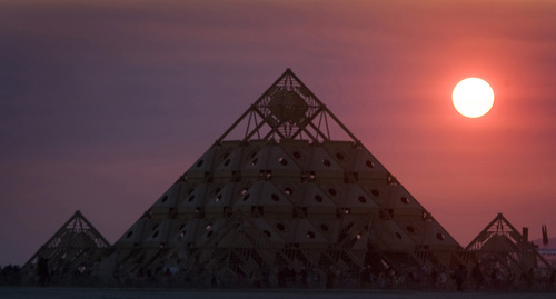 Rick Egan  | The Salt Lake Tribune   The sun rises over the Temple of Whollyness during the annual Burning Man Festival in the Black Rock Desert, Nev., Friday, August 30, 2013.