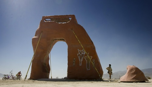 Rick Egan  | The Salt Lake Tribune   The PsycheDelicate Arch at Burning Man, Thursday, August 29, 2013. Built by Utah's regional burners, the arch went up in flames later that night with the other regional effigies.