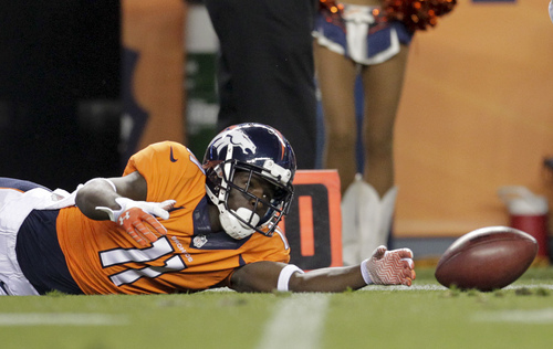 Denver Broncos wide receiver Trindon Holliday (11) fumbles the ball against the St. Louis Rams in the third quarter of a preseason NFL football game, Saturday, Aug. 24, 2013, in Denver. The Broncos recovered the ball on the play. (AP Photo/Joe Mahoney)