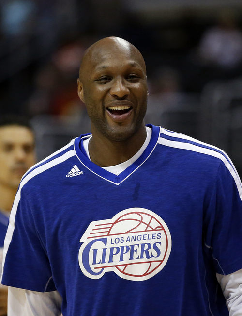 FILE - In this March 13, 2013, file photo, Los Angeles Clippers' Lamar Odom smiles during NBA basketball practice in Los Angeles. Odom was arrested for allegedly driving under the influence early Friday, Aug. 30, 2013, after a CHP officer saw his white Mercedes-Benz traveling erratically on a San Fernando Valley freeway. The CHP says Odom, 33, was arrested after failing a field sobriety test. (AP Photo/Jae C. Hong, File)