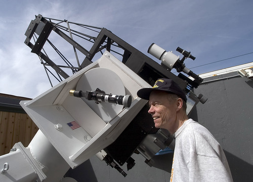 "NASA's ambassador to Utah Patrick Wigggins checks out the new 32 inch telescope at Harmons Obervatory at Stansbury Park.  It will be the largest public telescope in the state to look through.  Saturday at 4 pm there will be activities at ""Astronomy Days"" at the observatory.  There will be displays, and other telescopes available to look through providing the weather is clear.   Hartmann/photo  4/15/05"