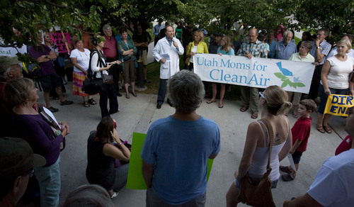 Steve Griffin | The Salt Lake Tribune  Citizens concerned about Rep. Chris Stewart's, R-Utah positions on science, the EPA and clean air regulations listen to Brian Moench, of the Utah Physicians for Healthy Environment, during a rally outside the Sweet Library in Salt Lake City, Utah Wednesday Sept. 4, 2013 before Stewart's town hall meeting in the Salt Lake City Avenues neighborhood.