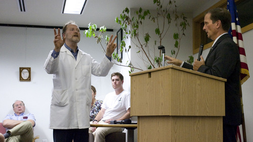Steve Griffin | The Salt Lake Tribune  Brian Moench, left, of the Utah Physicians for Healthy Environment, asks  Rep. Chris Stewart, R-Utah, a question about air quality during Stewart's town hall meeting in Sweet Library in Salt Lake City, Utah Wednesday Sept. 4, 2013.