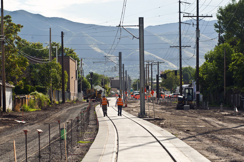 Chris Detrick  |  The Salt Lake Tribune Construction workers walk East on the Sugar House streetcar S Line Corridor near 800 East and 2200 South on Thursday. The streetcar is scheduled to be running for the public on December 8.