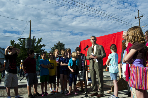 Chris Detrick  |  The Salt Lake Tribune Surrounded by fifth and sixth-graders from Hawthorne Elementary, Salt Lake City Mayor Ralph Becker speaks at the Sugar House streetcar S Line Corridor near 800 East and 2200 South Thursday September 5, 2013. The streetcar is scheduled to be running for the public on December 8.
