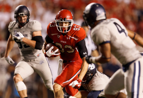 Trent Nelson  |  The Salt Lake Tribune Utah Utes wide receiver Sean Fitzgerald (83) runs the ball as the University of Utah hosts Utah State, college football Thursday, August 29, 2013 at Rice-Eccles Stadium in Salt Lake City.