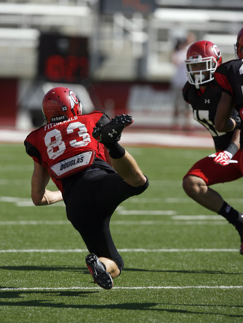Francisco Kjolseth  |  The Salt Lake Tribune Sean Fitzgerald tries to reach for a pass as the University of Utah's football team holds their first preseason scrimmage at the stadium on Tuesday, August 13, 2013.