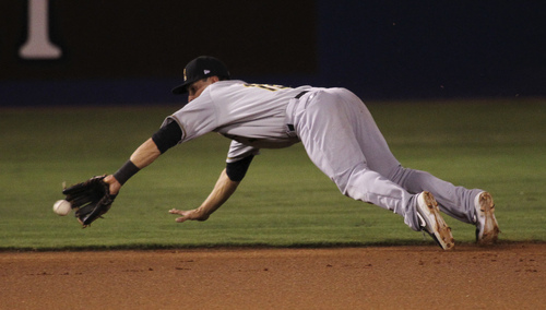 Salt Lake shortstop Tommy Field makes a diving play in the field during game #3 of the Pacific Conference Championship Series in Las Vegas on Sept. 6, 2013. (Jason Bean/Las Vegas Review-Journal)