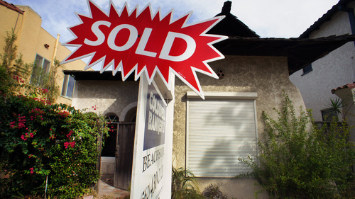 In this Monday, Sept. 2, 2013 photo, a sold sign is posted outside a house in Long Beach, Calif. Freddie Mac reports on mortgage rates for the first week of September on Thursday, Sept. 5, 2013. (AP Photo/Nick Ut)