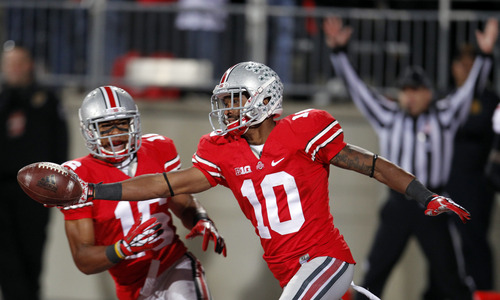 FILE - In this Oct. 6, 2012 file photo, Ohio State wide receiver Corey Brown (10) celebrates after returning a punt 76 yards for a touchdown during an NCAA college football game against Nebraska in Columbus, Ohio. Before you can star as a receiver or running back at Ohio State, you have to be willing to chase down returners and protect your kickers. It's a tenet of coach Urban Meyer's that everybody who wants playing time earns it on special teams. (AP Photo/Tony Dejak, File)