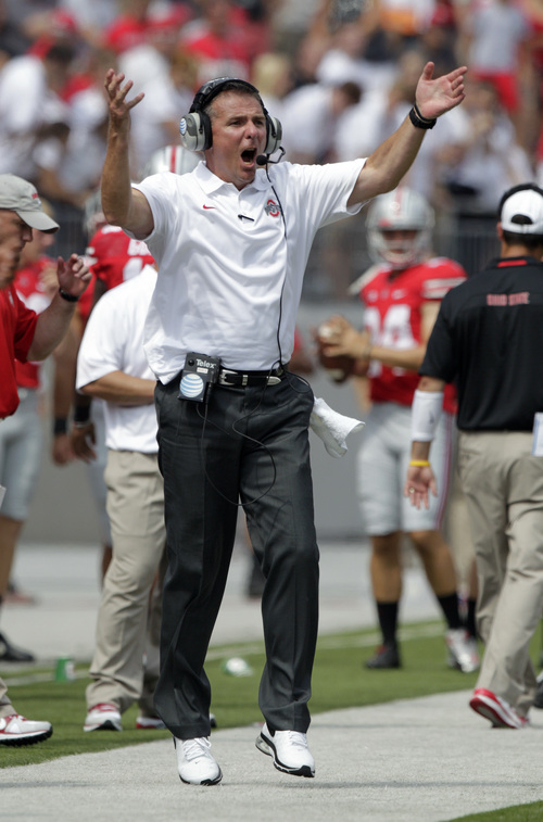 Ohio State head coach Urban Meyer shouts to his team during the third quarter of an NCAA college football game against Buffalo Saturday, Aug. 31, 2013, in Columbus, Ohio. Ohio State beat Buffalo 40-20. (AP Photo/Jay LaPrete)