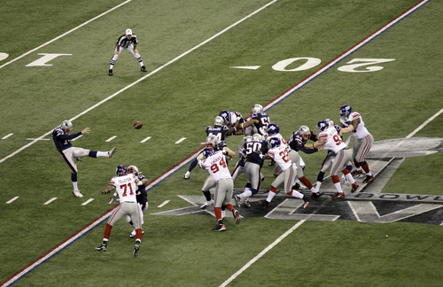 New England Patriots punter Zoltan Mesko punts against the New York Giants during the first half of the NFL Super Bowl XLVI football game Sunday, Feb. 5, 2012, in Indianapolis. (AP Photo/Charlie Riedel)