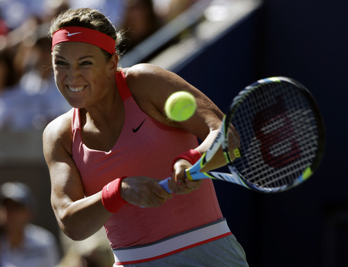 Victoria Azarenka, of Belarus, returns a shot to Flavia Pennetta, of Italy, during the semifinals of the 2013 U.S. Open tennis tournament, Friday, Sept. 6, 2013, in New York. (AP Photo/David Goldman)