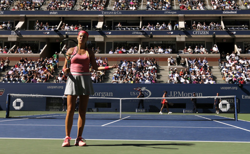 Victoria Azarenka, of Belarus, reacts after a point lost to Flavia Pennetta, of Italy, during the semifinals of the 2013 U.S. Open tennis tournament, Friday, Sept. 6, 2013, in New York. (AP Photo/Charles Krupa)