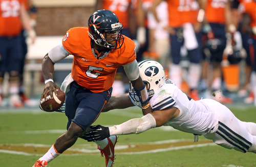 Virginia quarterback David Watford (5) is pressured by BYU linebacker Kyle Van Noy (3) during the first half of an NCAA college football game, Saturday, Aug. 31, 2013, in Charlottesville, Va. Virginia defeated BYU 19-16. (AP Photo/The Daily Progress, Andrew Shurtleff)