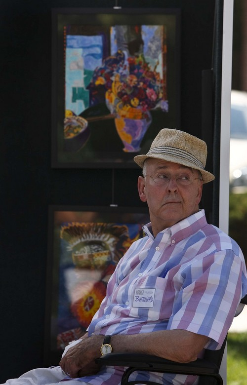 "Leah Hogsten | The Salt Lake Tribune Avenues Street Fair featured artist, Bernard Simbari, a retired dermatologist who has lived in the Avenues for almost 30 years, watches passersby at his booth of colored pen ""paintings"" , Saturday, September 7, 2013. The event started as neighbors sharing tools, wine and cheese back in the 1970s, then expanded to a full-fledged event with entertainment and local vendors."