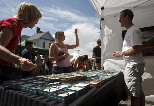 Leah Hogsten | The Salt Lake Tribune Taylor Grenis (center)purchased three sea glass necklaces by artist Don Prys (right) the annual Avenues Street Fair, Saturday, September 7, 2013. The event started as neighbors sharing tools, wine and cheese back in the 1970s, then expanded to a full-fledged event with entertainment and local vendors.