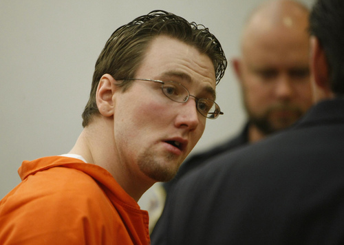 Joshua Binkerd looks over at his attorney Ed Jones just before being taken out of court.  Binkerd was sentenced to 2 to 20 years in prison with the recommendation of Judge Derek Pullan's he serve the full twenty for his part in the shooting death of Ashley Sparks in 2008.  Binkerd was sentenced in the Wasatch County Courthouse in Heber City, Utah.  Wednesday, June 16, 2010  Stuart Johnson, Deseret News