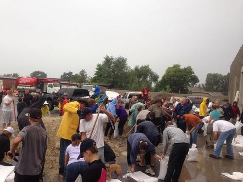 Residents of Alpine rush to fill sandbags after a flood threatened to damage homes Saturday Sept. 7, 2013 | Courtesy of the Lone Peak Police Department.