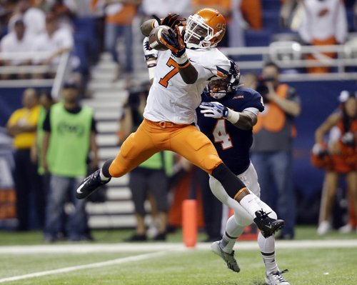 Oklahoma State's Brandon Sheperd (7) catches a pass for a touchdown as Texas San Antonio's Crosby Adams III (4) defends during the first quarter of an NCAA college football game, Saturday,  Sept. 7, 2013, in San Antonio. (AP Photo/Eric Gay)