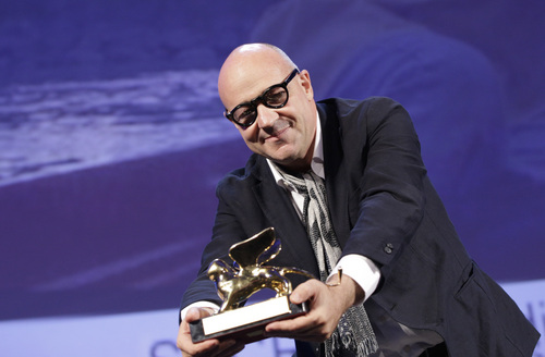 Director Gianfranco Rosi holds the Golden Lion for his film Sacro Gra, during the awards ceremony of the 70th edition of the Venice Film Festival in Venice, Italy, Saturday, Sept. 7, 2013. (AP Photo/Andrew Medichini)
