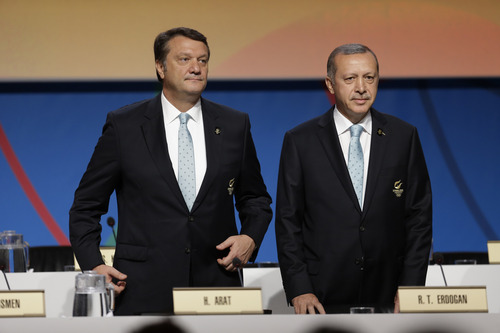 Turkey's Prime Minister Tayyip Erdogan, right, and Hasan Arat, chairman of Istanbul 2020, arrive to attend the Istanbul 2020 bid presentation during the International Olympic Committee session, Saturday, Sept. 7, 2013, in Buenos Aires, Argentina. Madrid, Istanbul and Tokyo are competing to host the 2020 Summer Olympic Games. (AP Photo/Natacha Pisarenko)