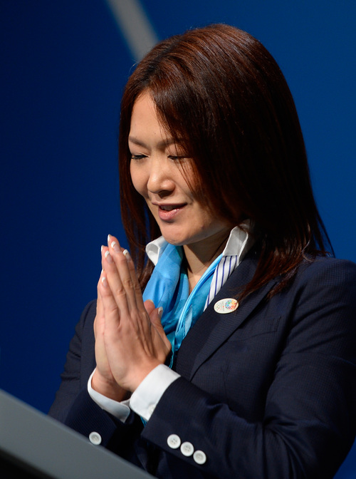 Paralympian Mami Sato speaks during the Tokyo 2020 bid presentation in  Buenos Aires, Argentina, Saturday, Sept. 7, 2013. Madrid, Istanbul and Tokyo are competing to host the 2020 Summer Olympic Games.(AP Photo/Fabrice Coffrini, Pool)