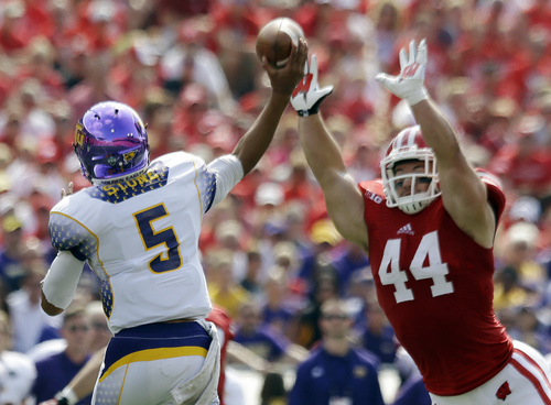 Tennessee Tech quarterback Darian Stone throws with Wisconsin linebacker Chris Borland rushing during the first half of an NCAA college football game Saturday, Sept. 7, 2013, in Madison, Wis. (AP Photo/Morry Gash)